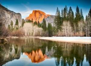 View of half dome reflected in the Merced river at Yosemite National Park